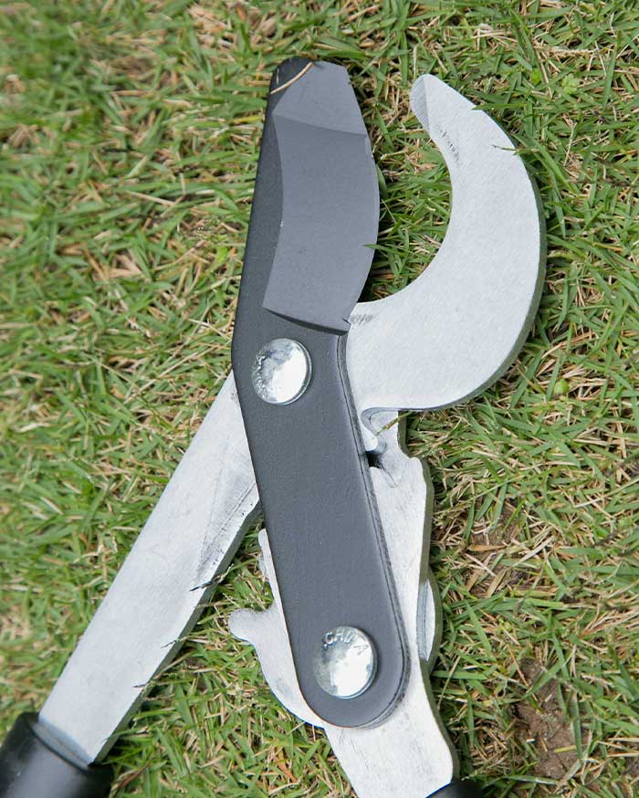 Why are most of the garden scissors designed as arcs and semi-ovals?